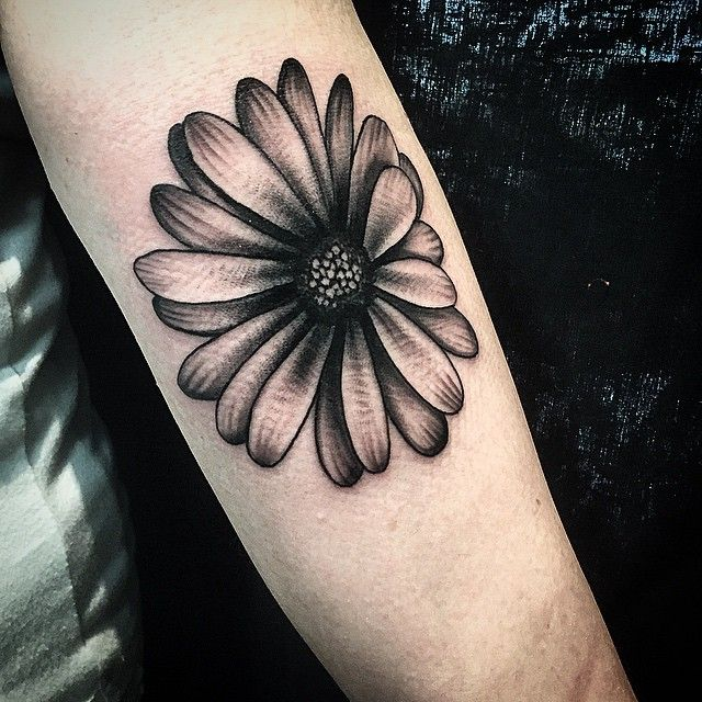 Daisy tattoo but would add some color and it'd be on my back/shoulder!
