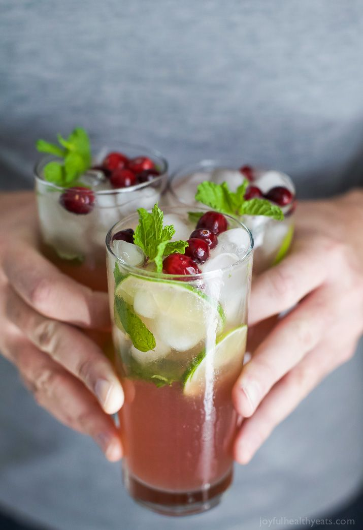 Holiday Cranberry Mojito Recipe made with fresh mint, cranberry and lime juice, agave nectar and rum. An easy party cocktail all made in one pitcher!