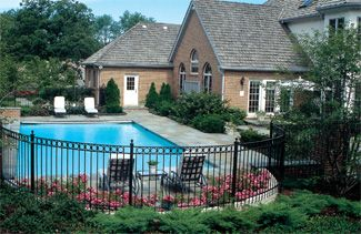 Iron fencing around pool outdoor living landscaping - Pool fence landscaping ideas ...