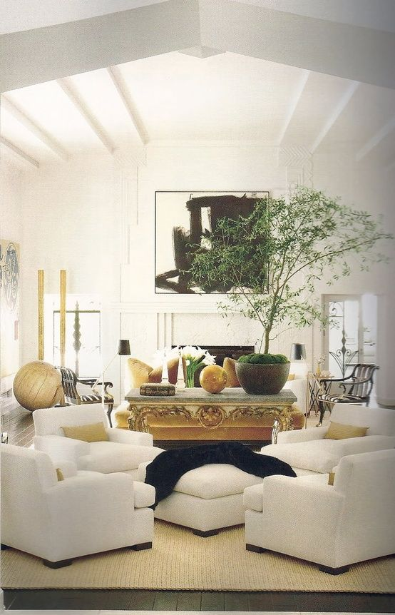 white living room...love the idea of four very comfortable chairs around one ottoman for great conversations.