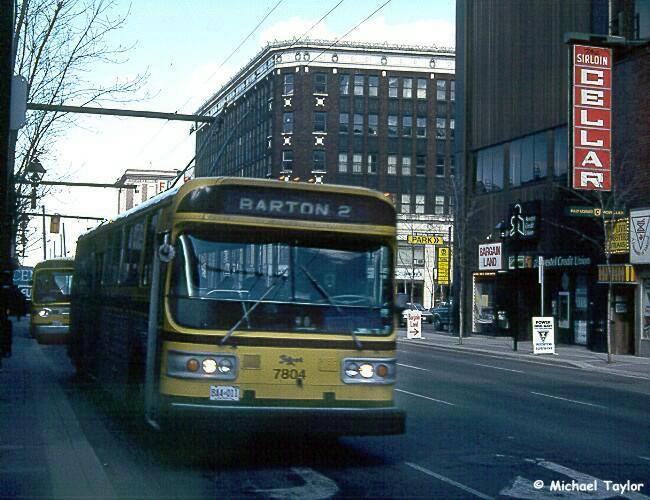 Flyer model E800 #7804 seen on James Street approaching King Street with a Barton service in April 1990. Credit: http://www.michaeltaylor.ca/
