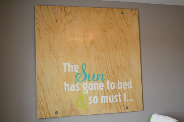 I like this large plywood wall art. Mount it on to the studs and it would still be safe above the crib.