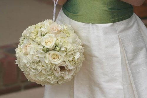 FLOWER GIRLS: small size, with ivory silk ribbon loop. use same flowers as bridesmaids bouquet... Pomander of roses and hydrangeas by Simon Lycett  www.simonlycett.co.uk