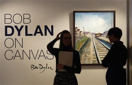 Employees stand near Bob Dylan's acrylic on canvas painting entitled ''Train Tracks 2'' during the Bob Dylan On Canvas exhibit at the Halcyon Gallery in London, February 10, 2010. REUTERS/Suzanne Plunkett