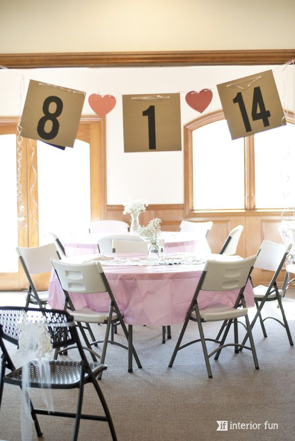 easy and super cute banner for a bridal shower made from simple cardstock ribbon other sweet shower decor and food items in