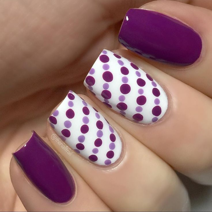 Simple purple dotty manicure. Love some polka dot nail art!