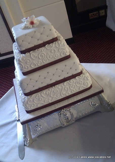 W063 - Four Tier Claret and White Wedding Cake with Swirls and Silver Dots by Jo's Cakes, via Flickr
