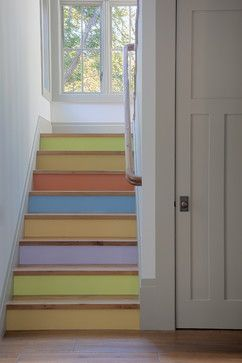 Painted stairs: Cheerful staircase with stair risers painted in pastel hued rainbow colors by Polsky Perlstein Architects via Houzz. How could you not be happy and smile walking up those stairs?