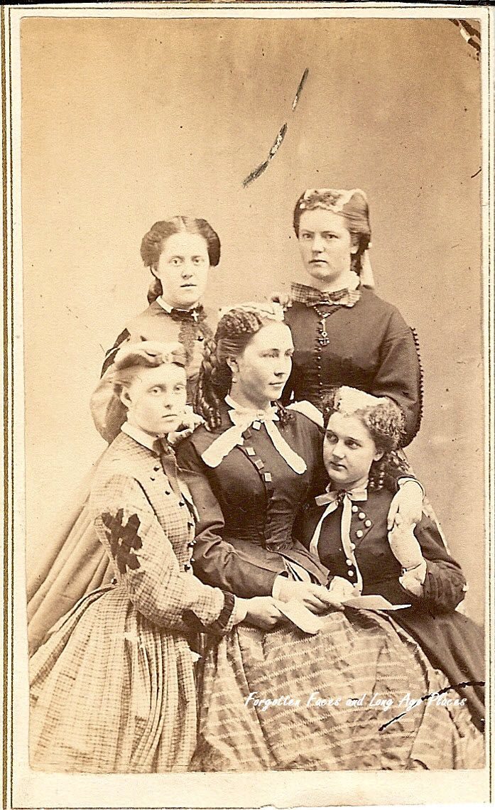 books0977: Mother and her four daughters from the Civil War era possibly reading a letter from the front. CDV photograph. The carte de visite (abbreviated CDV) was a type of small photograph which was patented in Paris by photographer André Adolphe Eugène Disdéri in 1854, although first used by Louis Dodero. It was usually made of an albumen print (2.125 in x 3.5 in), which was a thin paper photograph mounted on a thicker paper card (2.5 in x 4 in).