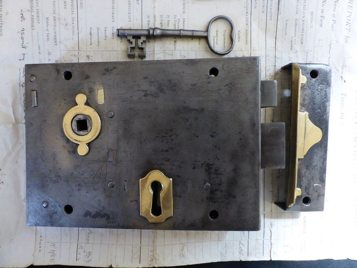 antique door locks. a huge antique cast iron rim lock with brass detailing and locking mechanism it comes door locks