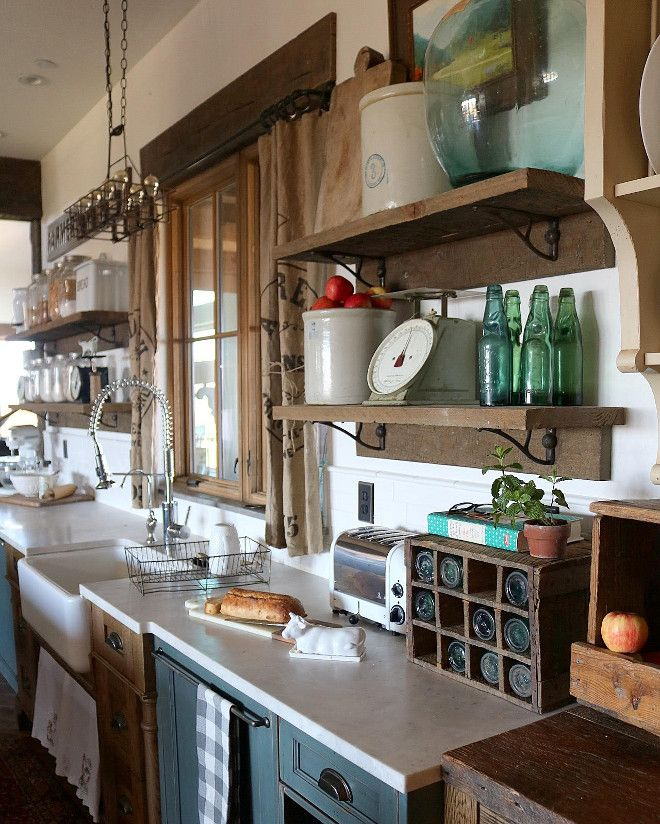 The open shelving also adds to the farmhouse charm that we adore. For the open shelves, we used 2 x 12 solid oak. It's two slabs, the bottom is glued and brad nailed into the wall, and then I found antique brackets to hold up the second slab that is the shelf.  Window Treatment: Found antique grain sack.  Farmhouse sink is Shaw's Original farmhouse sink.