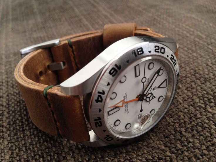 Looking for pics of 42mm explorer 2 on leather bands?