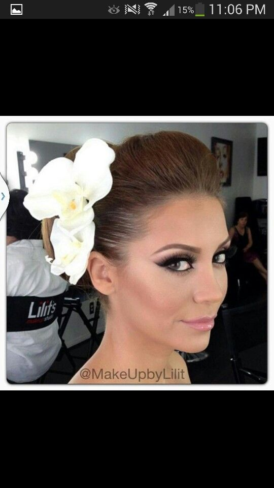 Amazing bridal makeup and hair minus the huge flower.