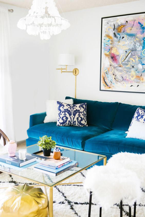 Check out our 15 top swoonworthy pinterest living rooms on OWT. We love this loo…  Check out our 15 top swoonworthy pinterest living rooms on OWT. We love this look with the blue velvet sofa and gorgeous white and gold accents.  www.ohwhatsthis.com/