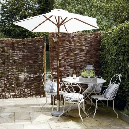 Charming outdoor eating area  Define your alfresco dining area or get extra privacy while you dine, with an attractive willow screen. A stylish parasol provides shade, while Provencal-style metal dining furniture is teamed with pretty cushions to add to the country-style feel. Complete the look with rustic accessories and a few lanterns for when the sun goes down.