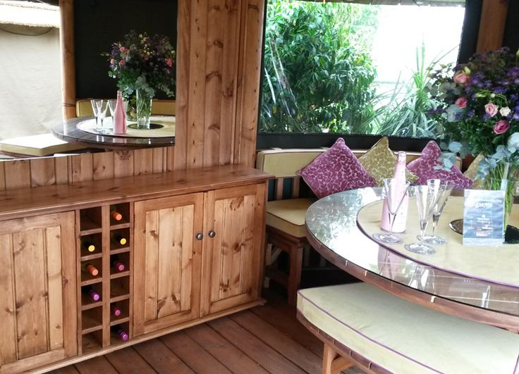 This stunning Oval Safari Breeze House features a central cabinet perfect for storing wine, crockery, glasses and your favourite book. View our full range online! #BreezeHouse #gardenbuilding #gazebo #wine #storage