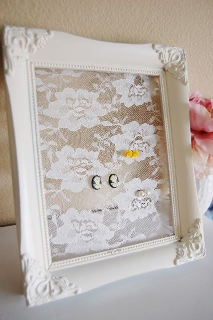Spray paint an antique picture frame, staple lace to the back, and ta-da! a beautiful earring holder. wow great idea