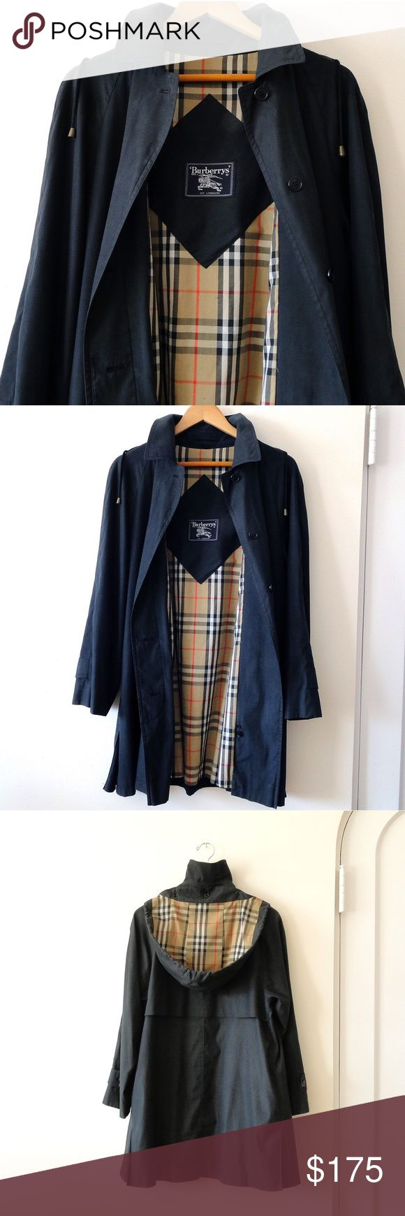 Burberry women's size 6 raincoat Burberry's of London size 6 women's rain coat. Perfect condition. A line, black, classic Burberry lining. Removable hood attached with buttons. While not waterproof, this is a rain jacket. Burberry Jackets & Coats Trench Coats