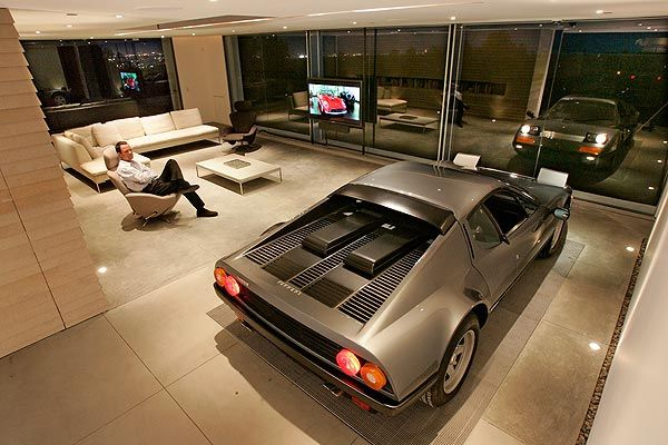 "Holger Schubert's Ferrari 512 BBi ""Boxer"" is parked in the living room of his Brentwood home. Awesome."