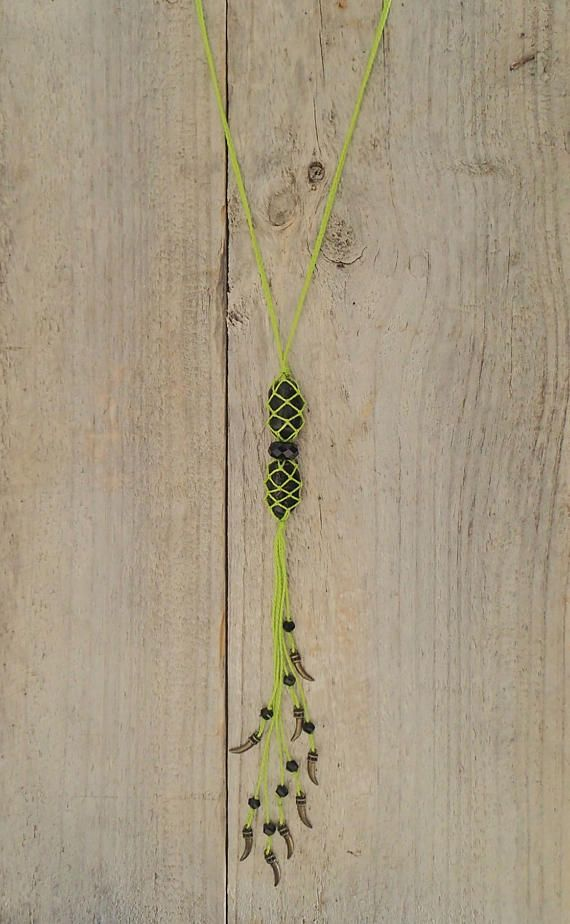 Beautifully handcrafted macrame necklace, created using silky lime green cotton cord woven around two pieces of polished black Onyx. Onyx is a wonderful stone for warding off negativity, as well as a great aid for relaxation. The tail is dotted with delicate bronze tusk charms and black crystals. Measuring approximately 59cm in length, this necklace is perfect for boho layers.