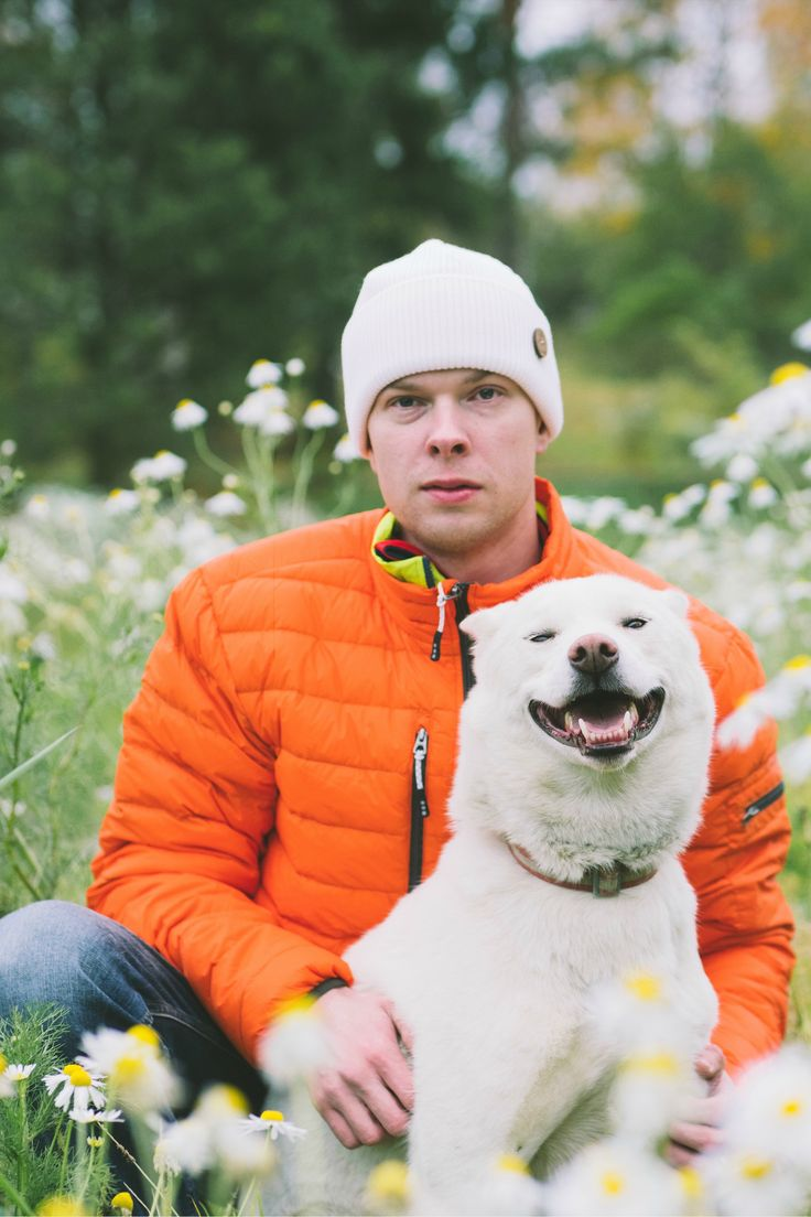 Doggy and their daddy portrait, dog photography. Dog in a field of flowers. Laughing doggo.