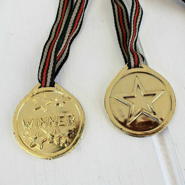 12 Winner's Medals For Sports Day Or Party Games  Host your own Sports Day and hang these medals around the winners'! These 12 medals with ribbon are great for giving out as prizes to winners at a Sports Day or garden party game. Each medal has the world 'winner' with stars surrounding it. On the back of each medal is a single large star. It will really help the kids interact and engage with the games. A perfect extra for some fun and healthy competition!