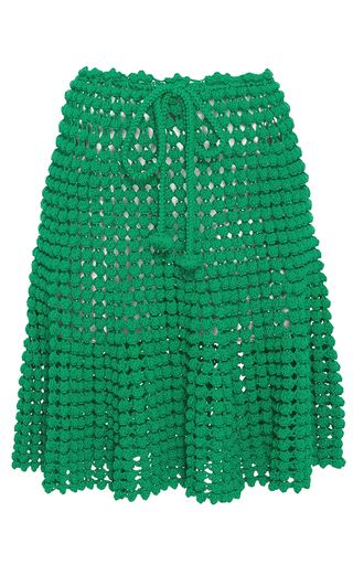 This **Helen Rödel** Popcorn Stitch Skirt is rendered in hand knit crochet and features a drawstring waist and flutter mini length hemline.