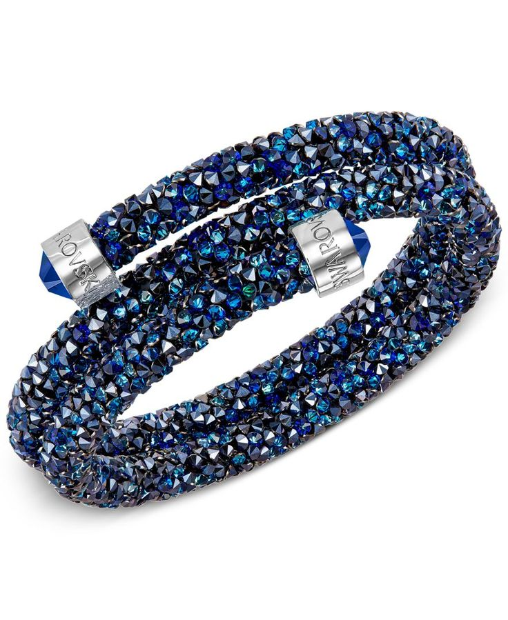 """Be a part of the glitterati in this glamorous crystaldust drop bracelet designed by Swarovski. Available with gold-tone and silver-tone mixed metal detail. Approximate diameter: 2-1/8"""". 
