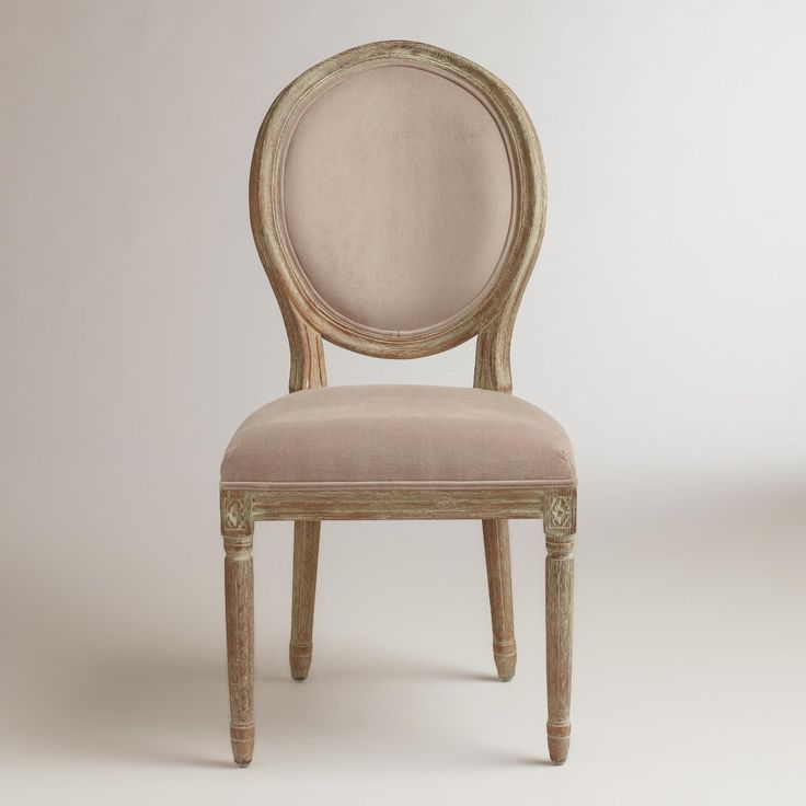 Boasting a curved, shapely silhouette, our Cocoa Paige Round Back Dining Chairs simply define elegance. Crafted of white American oak, they feature a distressed finish that adds to their classic appeal.