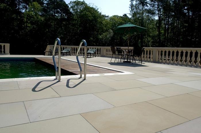Sawn and sandblasted sandstone not only looks stunning around a swimming pool but importantly its safe and non slip