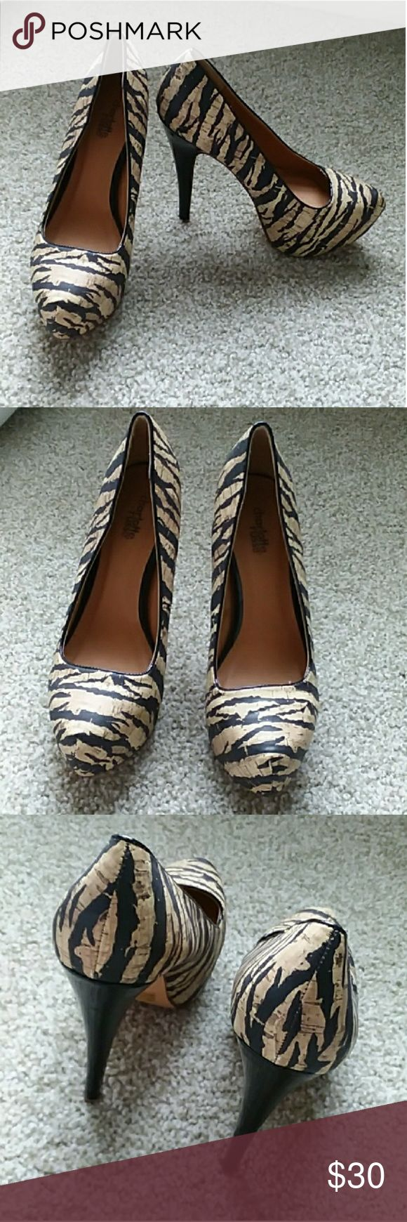 "Charlotte Russe Zebra Heels Adorable Charlotte Russe Zebra Print Heels that go with so much!  - There is a little damage to the heels but not noticeable at all when wearing! ( Shown in pic #4) Other than that they are in great Condition!  - Heel is about 5.5""  Please feel free to make a reasonable offer! Charlotte Russe Shoes Heels"