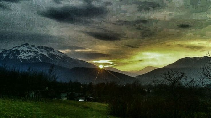 mountain, tranquil scene, scenics, tranquility, sky, beauty in nature, mountain range, landscape, nature, cloud - sky, idyllic, sunset, tree, grass, non-urban scene, sun, weather, cloudy, lake, cloud