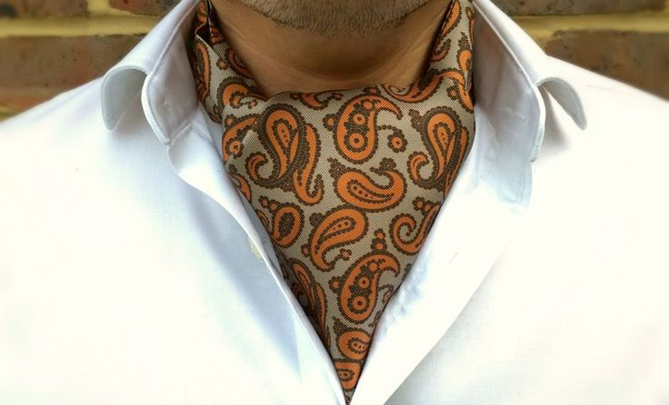 IDRIS Printed Silk Cravat #cravat #ascot #tie #daycravat #silkcravat #silk #cravats #ascots #madeinengland #wedding #groom #groomswear #weddingideas #idea #grooms #style #weddingstyle #outfit #inspiration #weddingguest #guest #usher #ushers #buybritish #accessories #dapper #gentleman #cravatclub #grey #brown #orange #paisley #paisleycravat #greycravat #orangepaisley