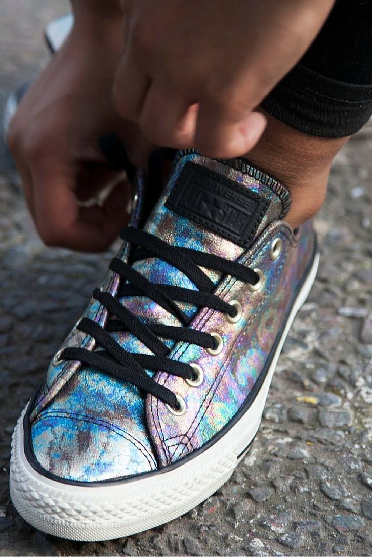 These 'oil slick' patterned All Star low tops from Converse are this season's newest drop.