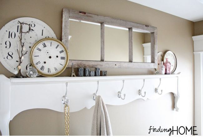 Old window mirror by Finding Home  Mirrors help bounce light around, especially useful in darker areas. Although this particular sample isn't used for looking into, it's my bet the entry way is much brighter because of it! Gorgeous!