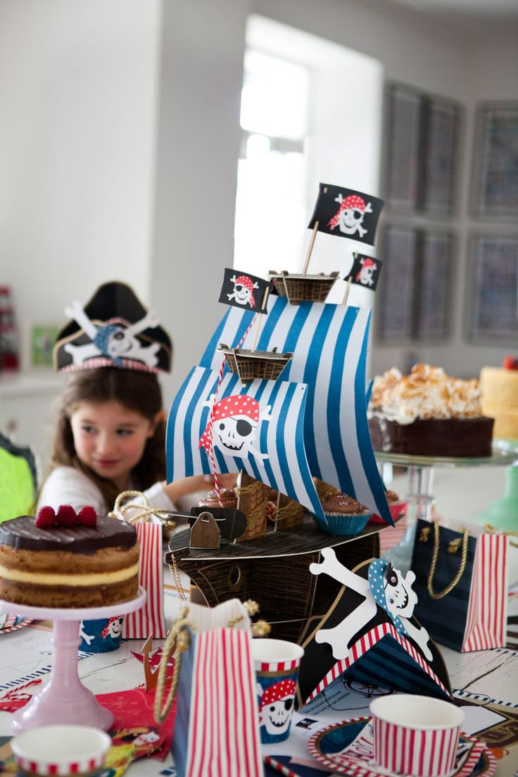Pirate-themed cupcake holder and pirate-themed paper cups, plates and party bags, all Leigh Tucker Willow