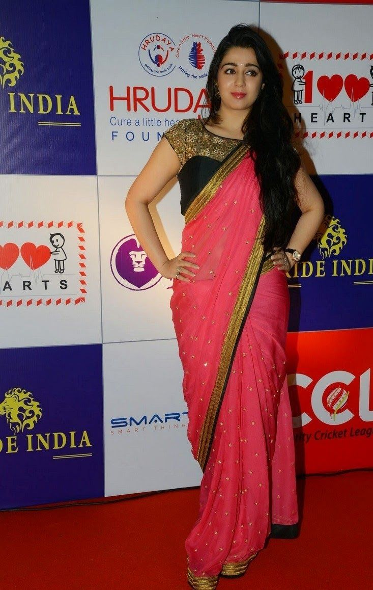 Actress Charmi Kaur Gorgeous In Bright Pink Chiffon Embroidery Saree
