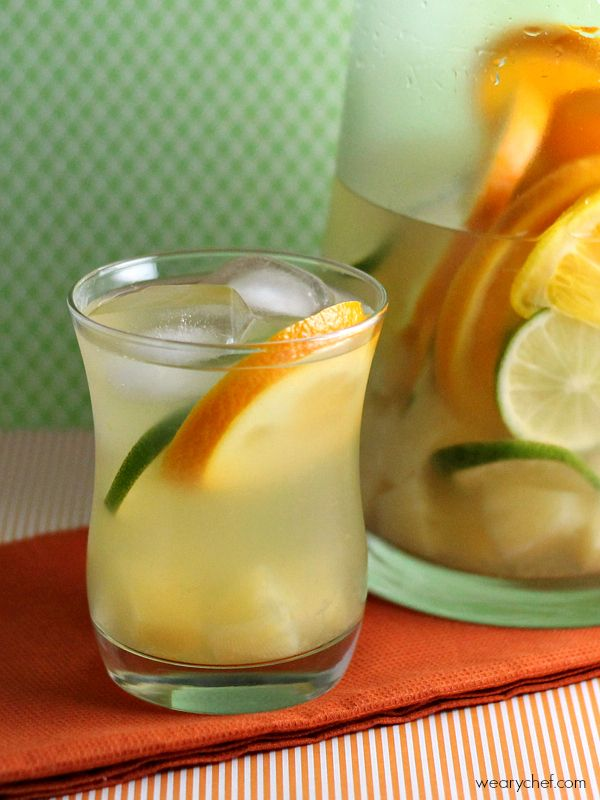 Tropical Pineapple Sangria - You will love this refreshing wine cocktail with coconut, pineapple, and citrus flavors!