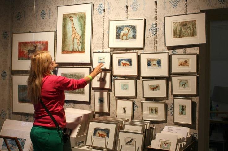 Maarit Kontiainen arranging her gallery