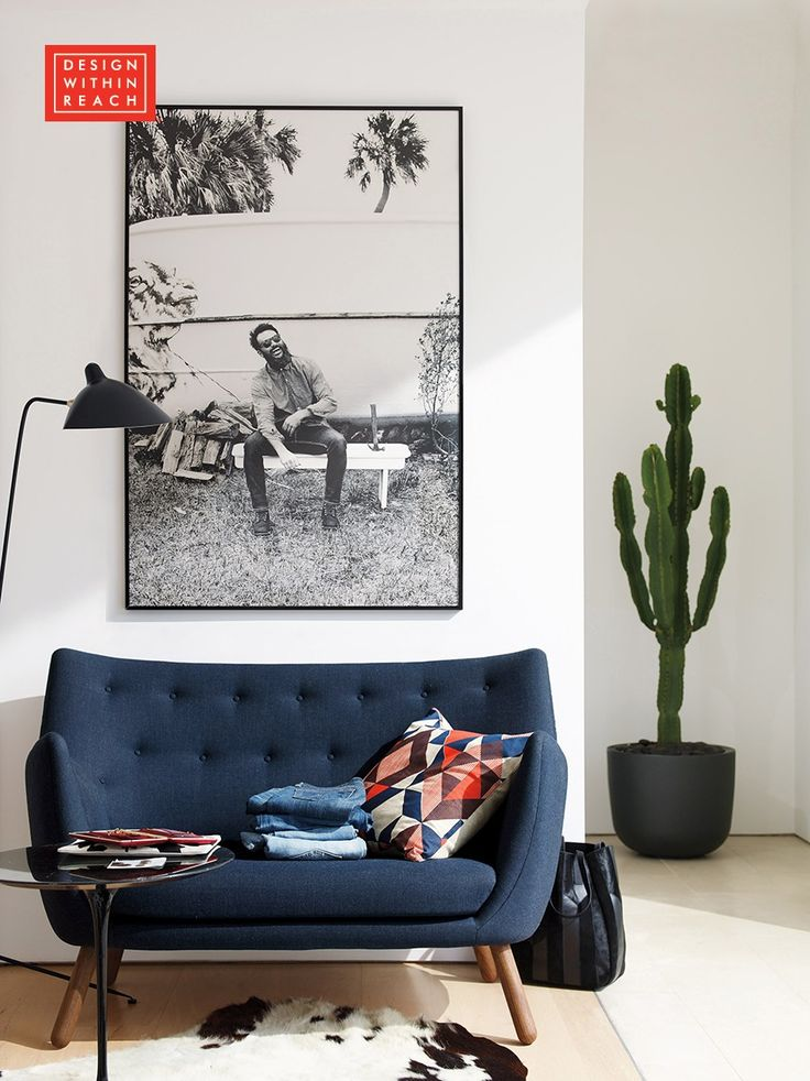 """Finn Juhl designed the Poet Sofa for use in his own home. It got its nickname when it appeared in the Danish film """"The Poet and His Wife."""""""