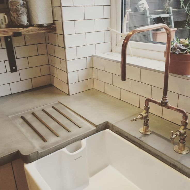 A better photo of our concrete work tops & copper pipe kitchen tap for…                                                                                                                                                                                 More
