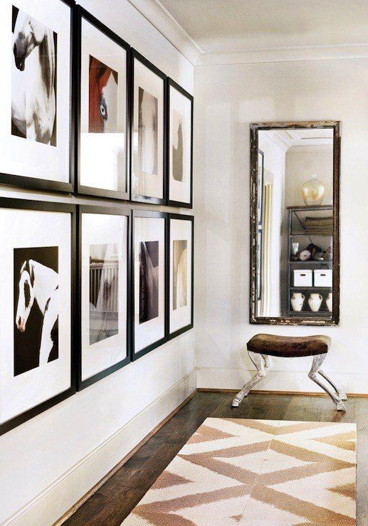 Create a personalized gallery-style look like this for your home by custom framing enlarged photos of your pets and family and hanging in a simple, symmetrical grouping. This is a great way to add personality to a hallway or large, blank wall and adds a designer touch!