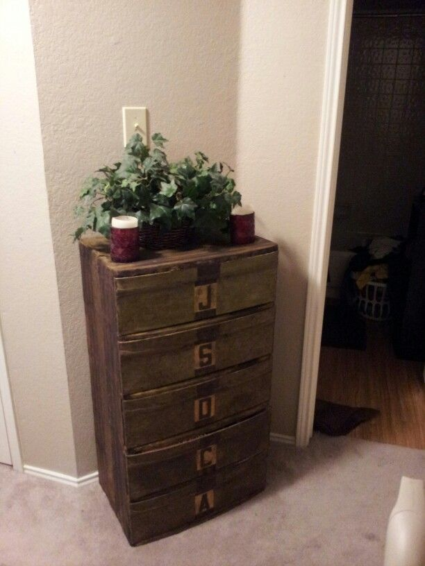 Old white plastic storage drawers turned memory chest