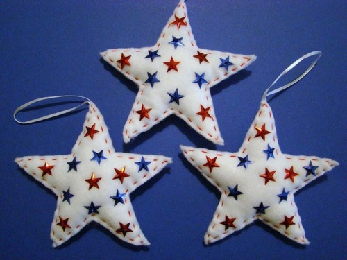 """This wonderful set of 3 Patriotic Star Ornaments are made of white felt and decorated with hand~sewn red and blue sequin stars and beads with red hand~stitching along the edges.They have a white satin ribbon on top for hanging and measure approx. 4"""".....Great for decorating a 4th of July tree."""