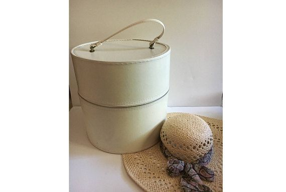 Check out this item in my Etsy shop https://www.etsy.com/listing/538472139/vintage-hat-box-large-ivory-cream-round
