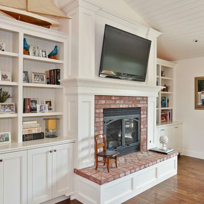 As part of a fireplace surround, we could add trim and molding around base of fireplace... the corners of our all-brick base always make me nervous when Tyler plays nearby. The built in bookshelves are fantastic!