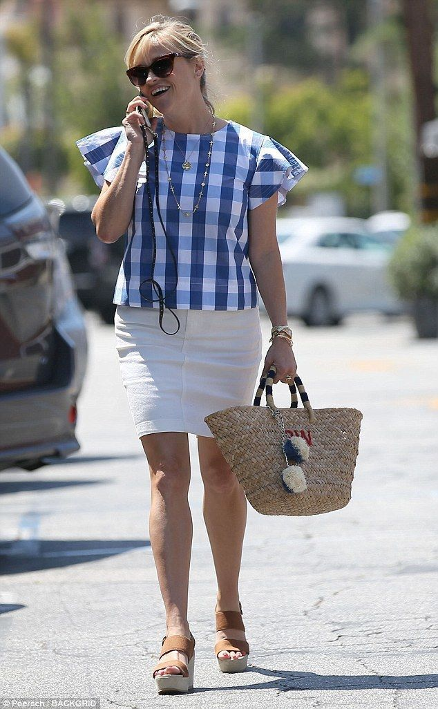 6d346e5a09e Reese Witherspoon beams in patterned blouse and white mini skirt in ...