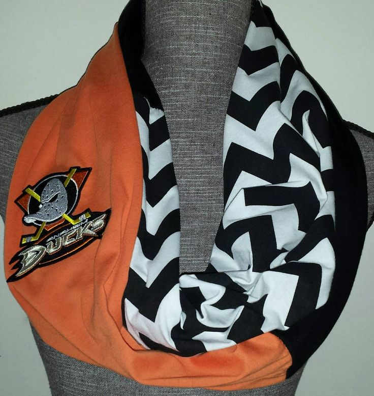 "Anaheim Ducks Infinity Scarf with embroidered logo directly onto the scarf. Not an iron on patch. The perfect accessory to show your team spirit. Hoop length is about 38"" inches long by about 8"" inche"