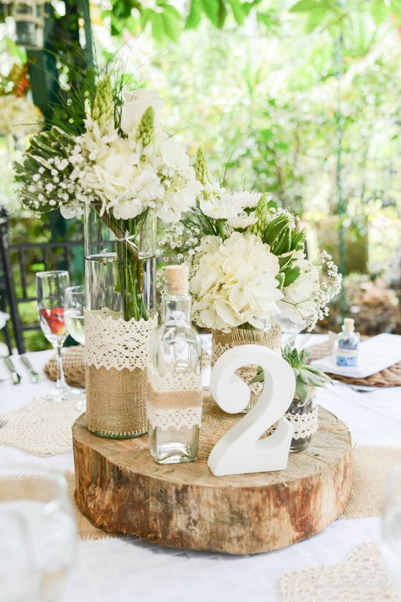 rustic burlap and lace wedding centerpieces via diana zuleta / http://www.deerpearlflowers.com/unique-wedding-centerpiece-ideas/2/