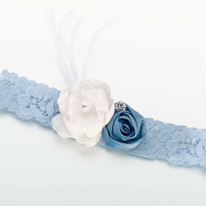 This soft blue garter combines blue lace with light ivory feathers and a pair of satin flowers. The smaller flower is a darker blue satin accented by a single rhinestone.